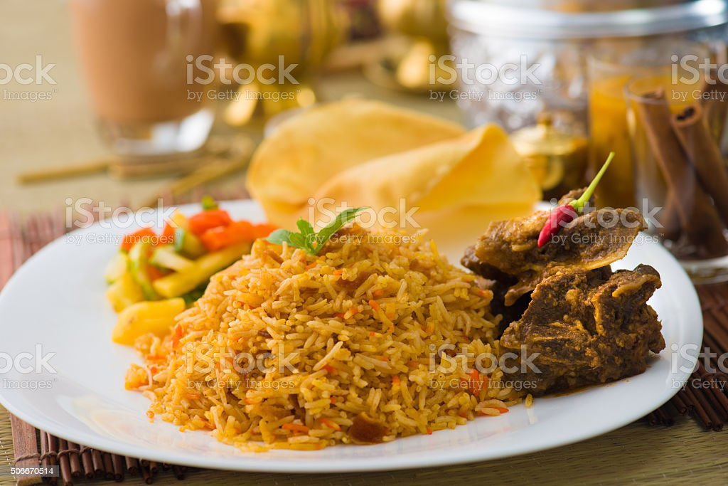 Biryani mutton rice papadam with traditional background stock photo