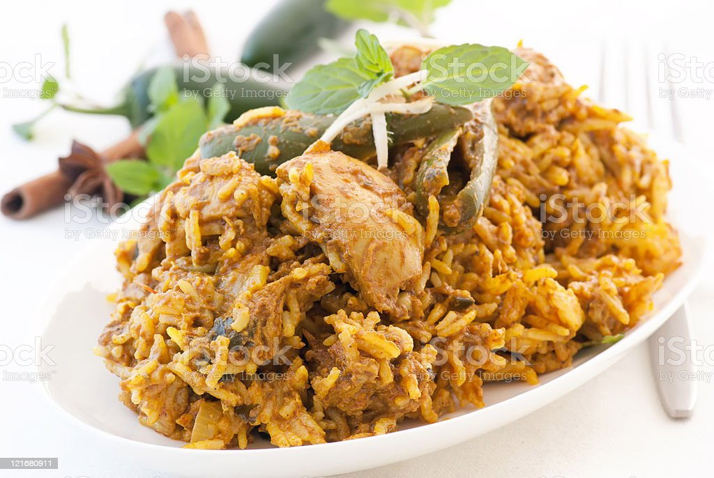Biryani serves on a white dish with fresh herbs stock photo