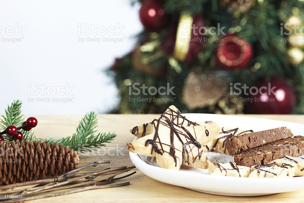 Biscotti and star cookies with christmas decorations on table royalty-free stock photo