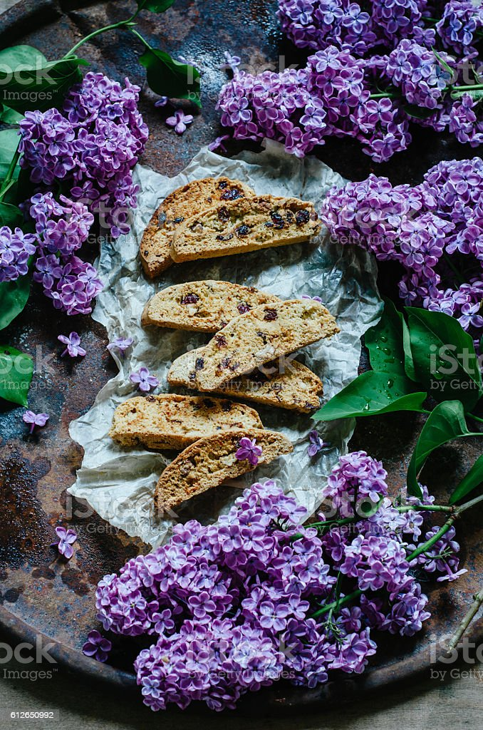 Biscotti or cantucci with raisins on on baking paper, traditiona stock photo