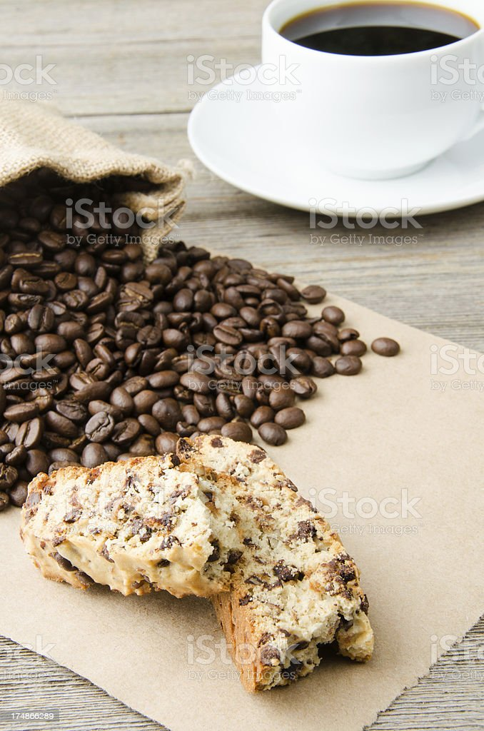 Biscotti with a Cup of Coffee and Beans Vertical royalty-free stock photo