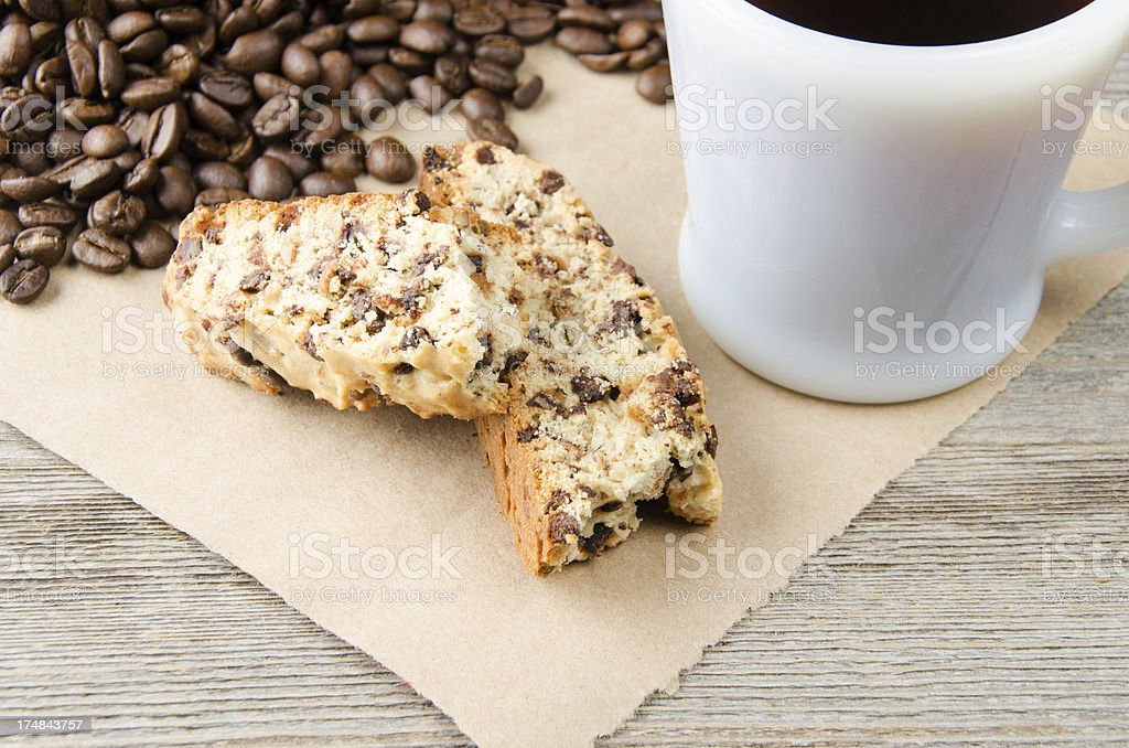 Biscotti with a Mug of Coffee and Beans Closeup royalty-free stock photo