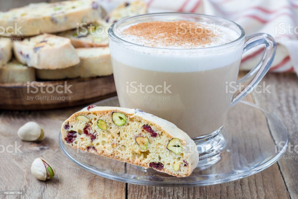 Biscotti with cranberry and pistachio with cup of coffee latte stock photo