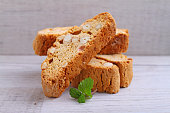 Biscotti with nuts on a wooden background