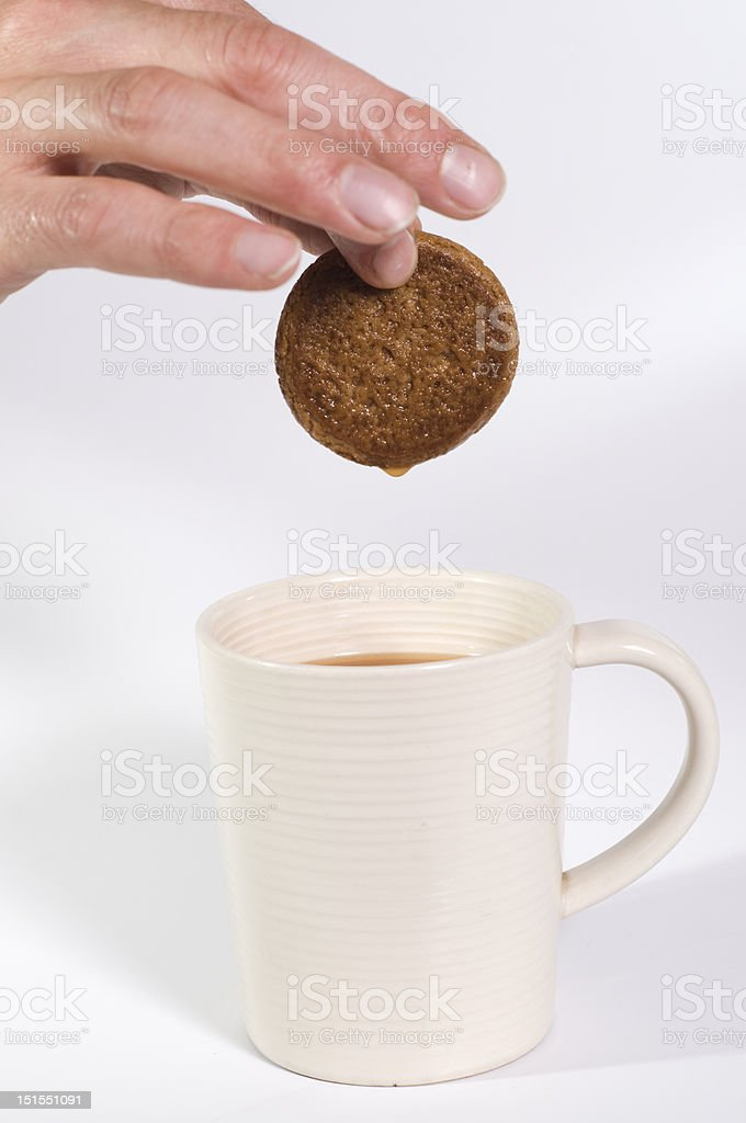 biscuit being dipped in tea stock photo