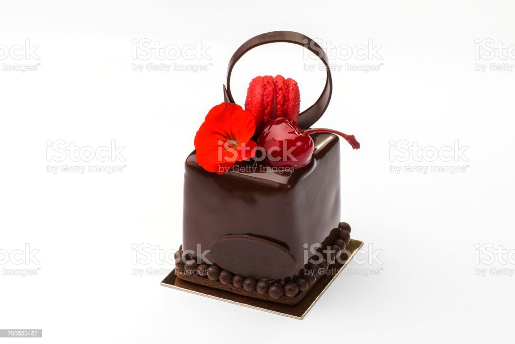 Biscuit cake with macaroons in chocolate with cherry stock photo