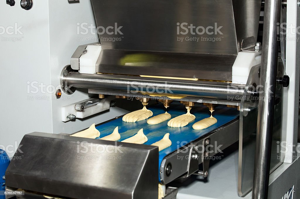 Biscuit depositing machine stock photo
