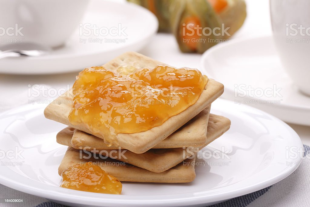 Biscuit with apricot jam stock photo