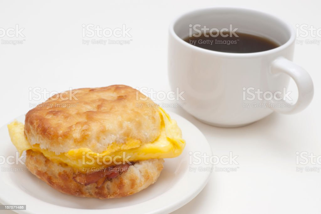 biscuit with bacon, cheese,  eggs and coffee royalty-free stock photo