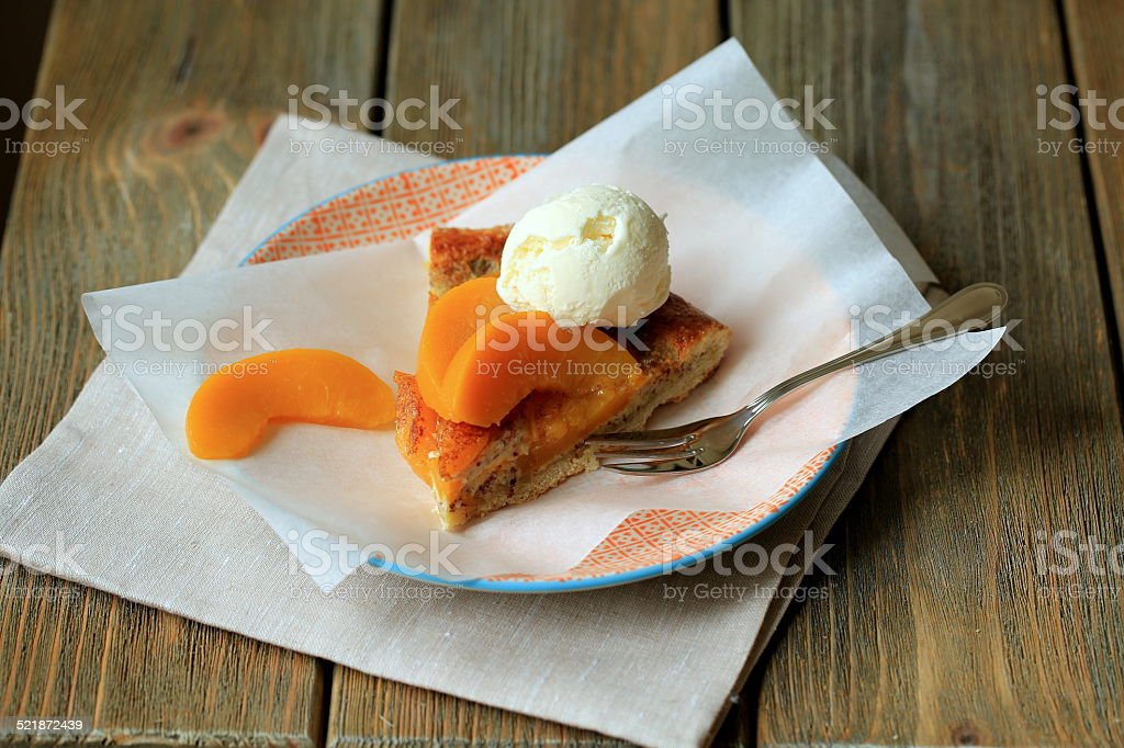 biscuit with canned peaches & vanilla ice cream stock photo