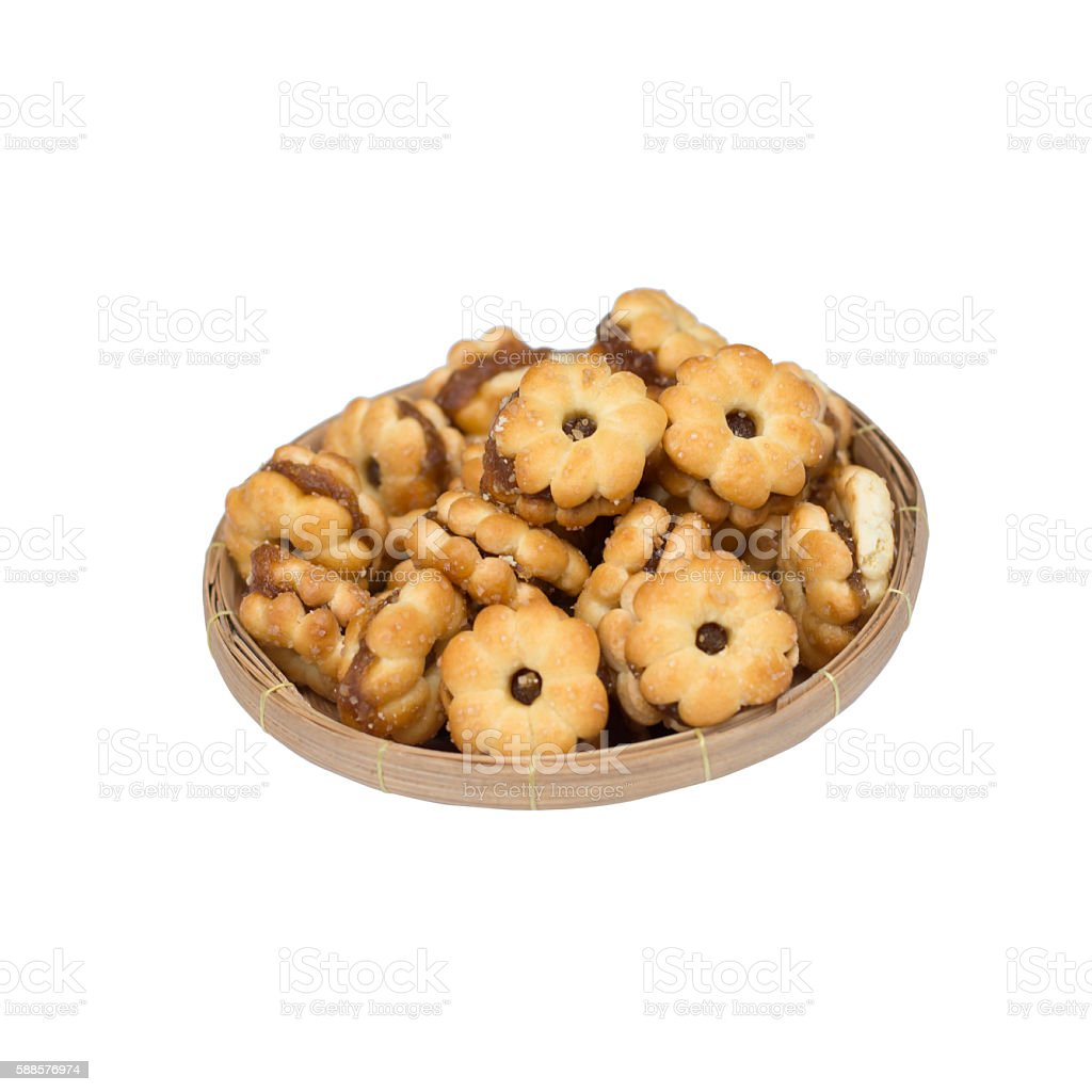 biscuits filled with pineapple jam in bamboo basket isolated on stock photo