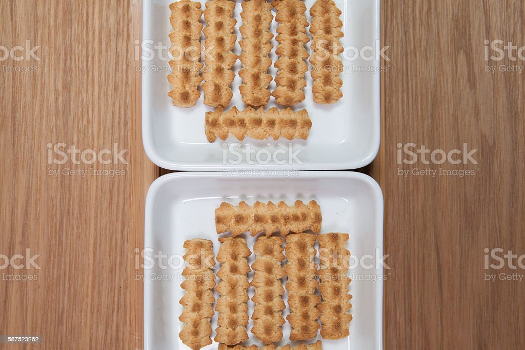 Biscuits in ceramic bowls on a wooden desk stock photo