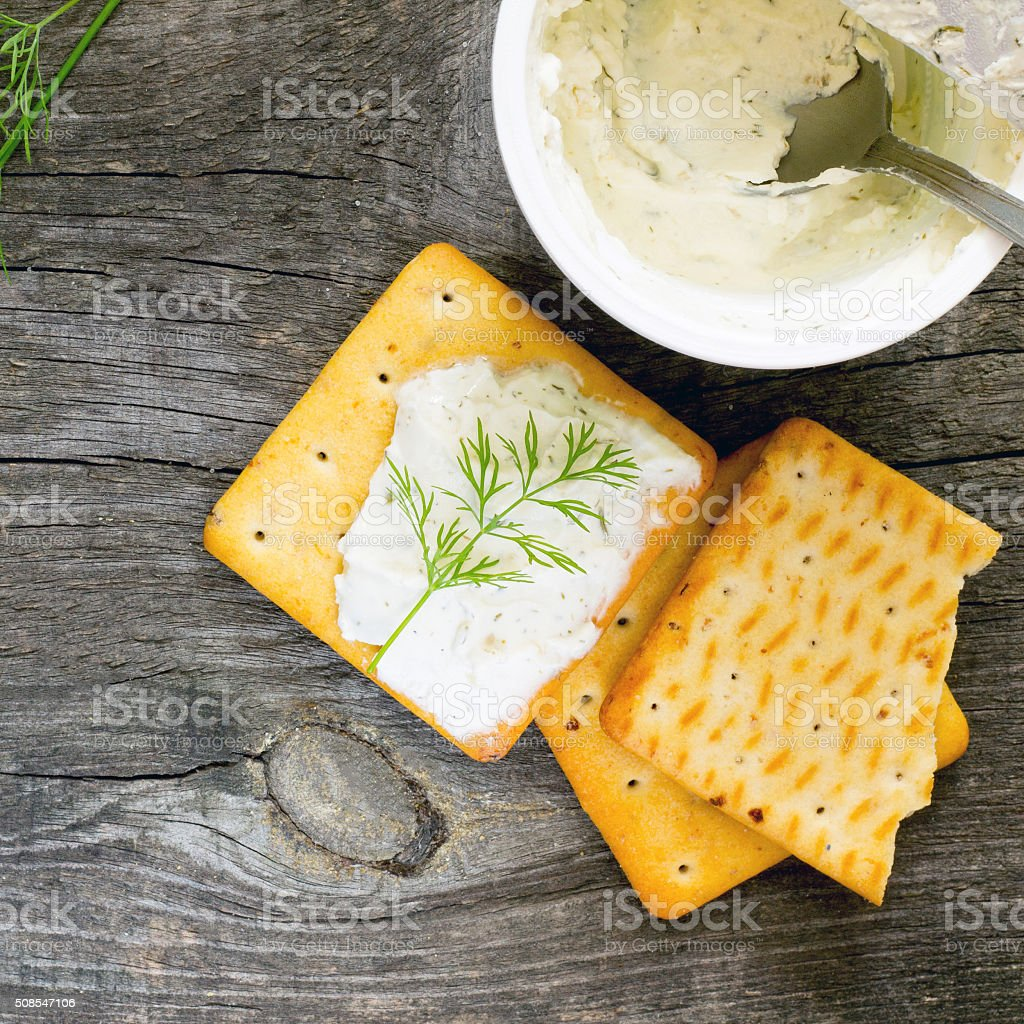 Biscuits salty crackers, dill and cream cheese, top view stock photo