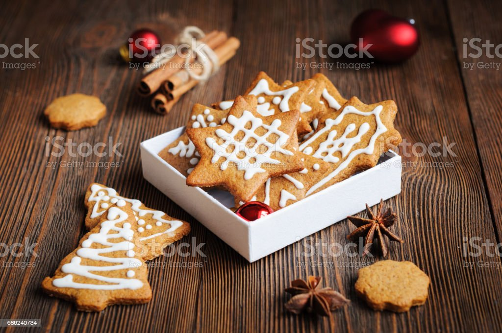Biscuits shaped in Christmas trees and stars stock photo