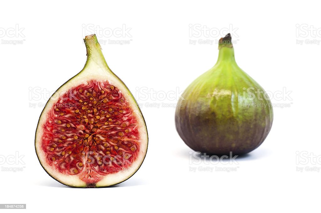 bisected and whole fig fruit isolated on white stock photo