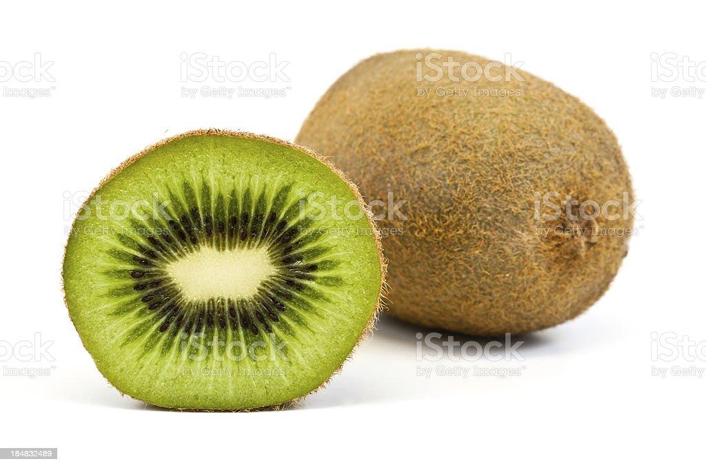 bisected and whole kiwi fruit isolated on white stock photo