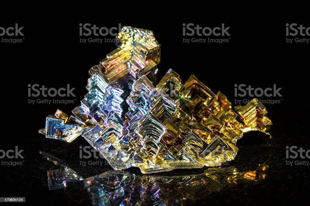 Bismuth in front of black stock photo