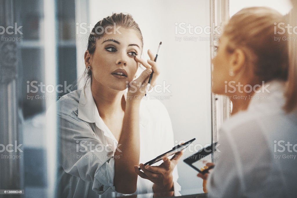 Bit of eye shadow and we're good to go. stock photo