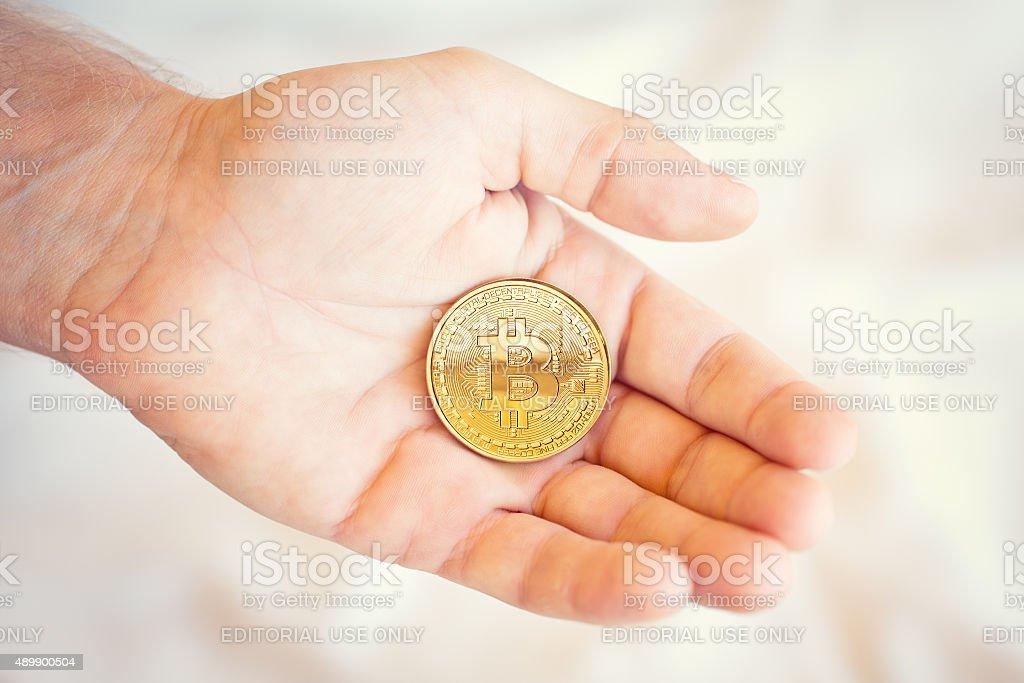 Bitcoin in a hand. stock photo