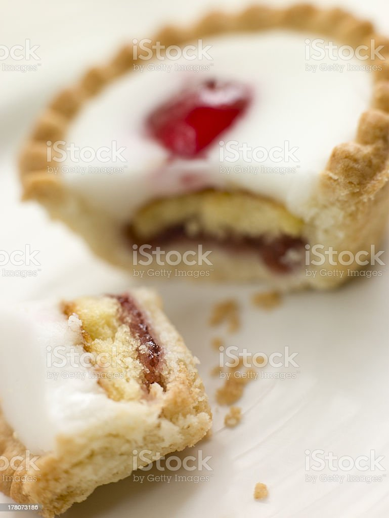 Bite of a Cherry Bakewell Tart stock photo