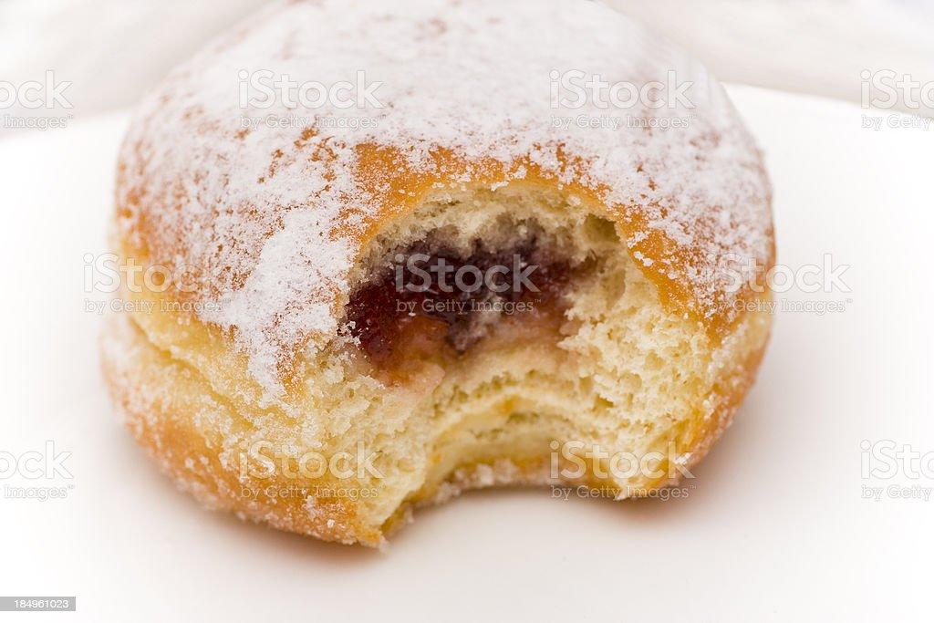 Bite of Jelly Doughnut stock photo