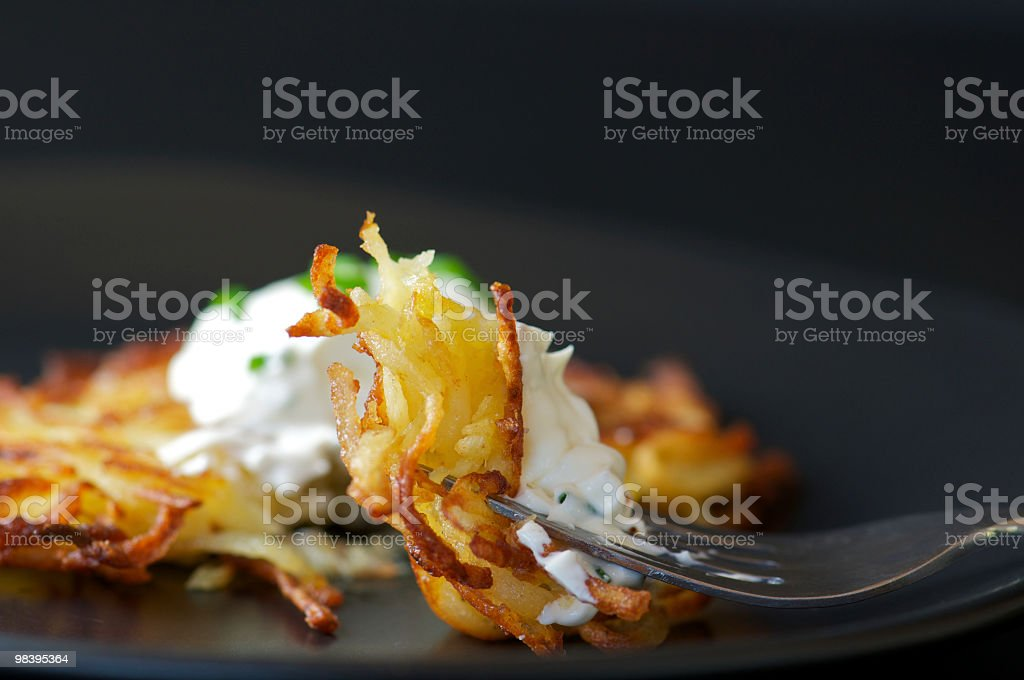 Bite of Potato Latke on Fork stock photo