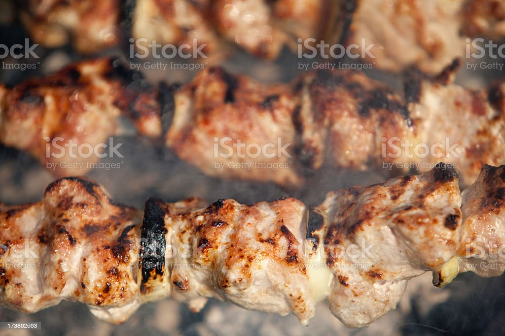 bite of roasted meat stock photo