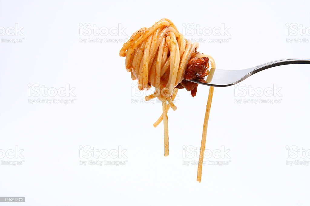 A bite of spaghetti Bolognese isolated on a fork stock photo