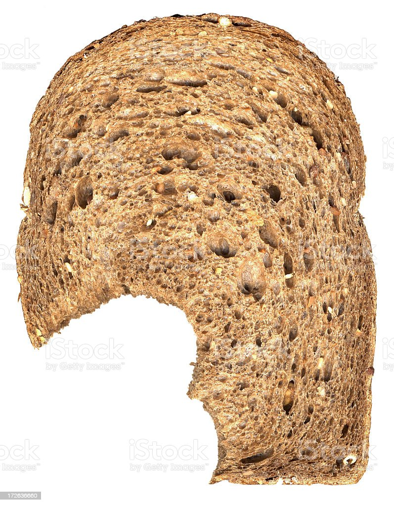 A bite taken out of a slice of bread stock photo