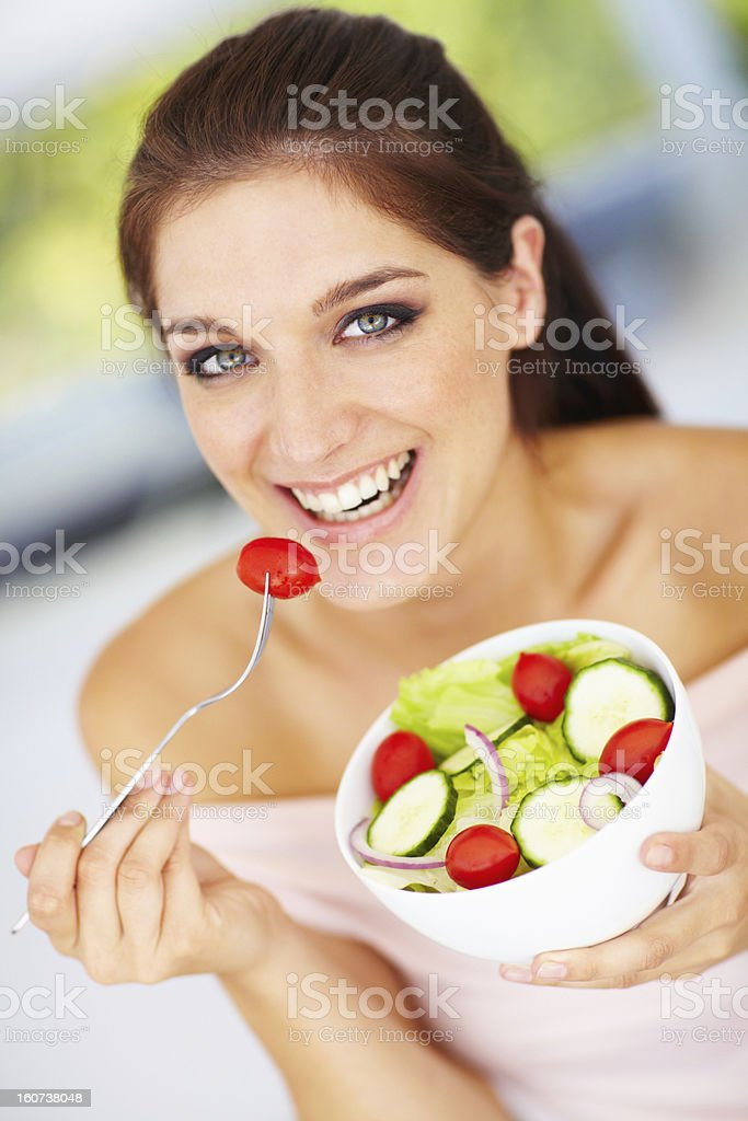 Biting into a bowl of freshness royalty-free stock photo