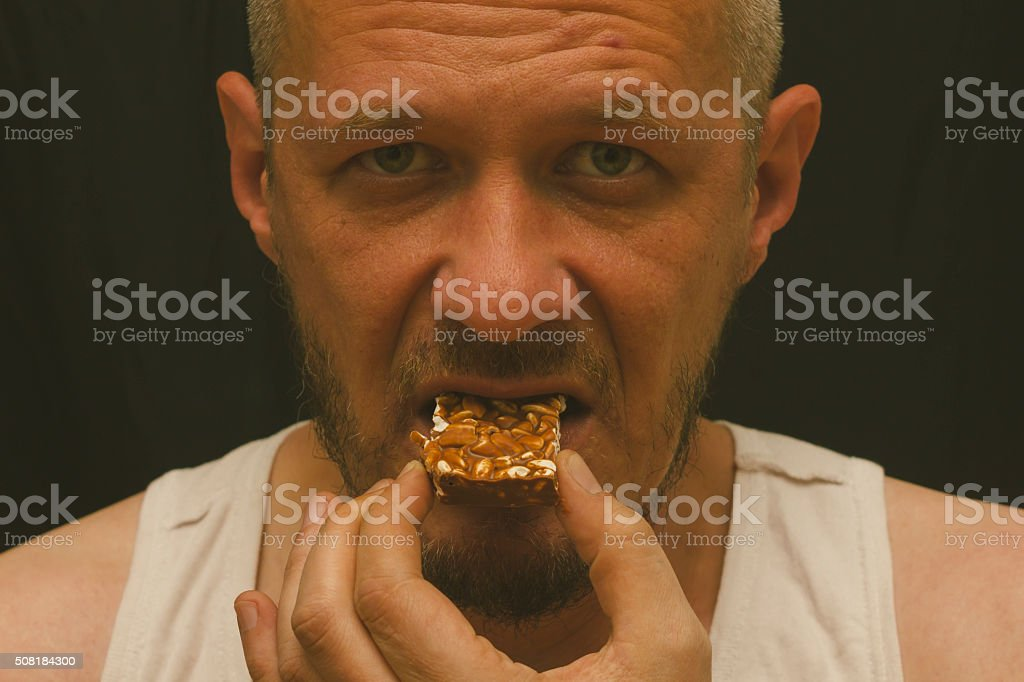 Biting piece of chocolate with rice stock photo