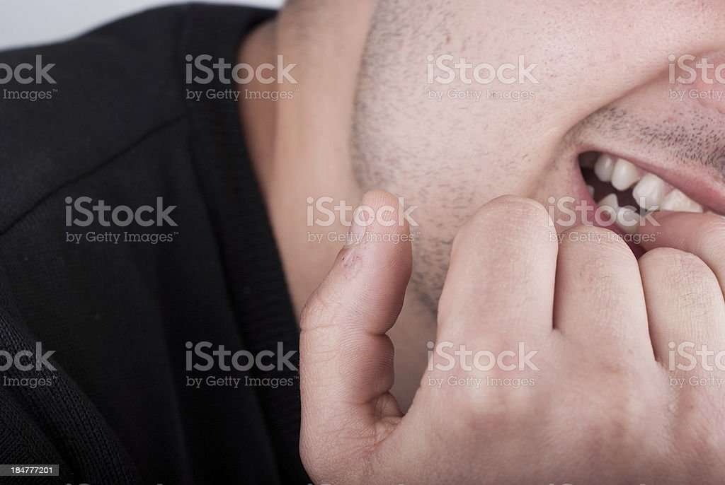 Biting the nails stock photo