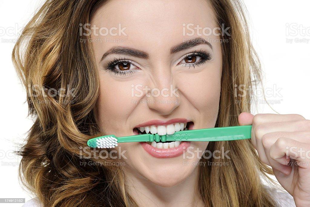 biting toothbrush royalty-free stock photo