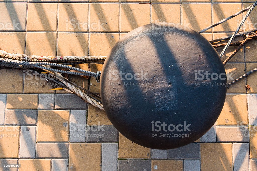 Bitt and mooring lines on a quay. stock photo