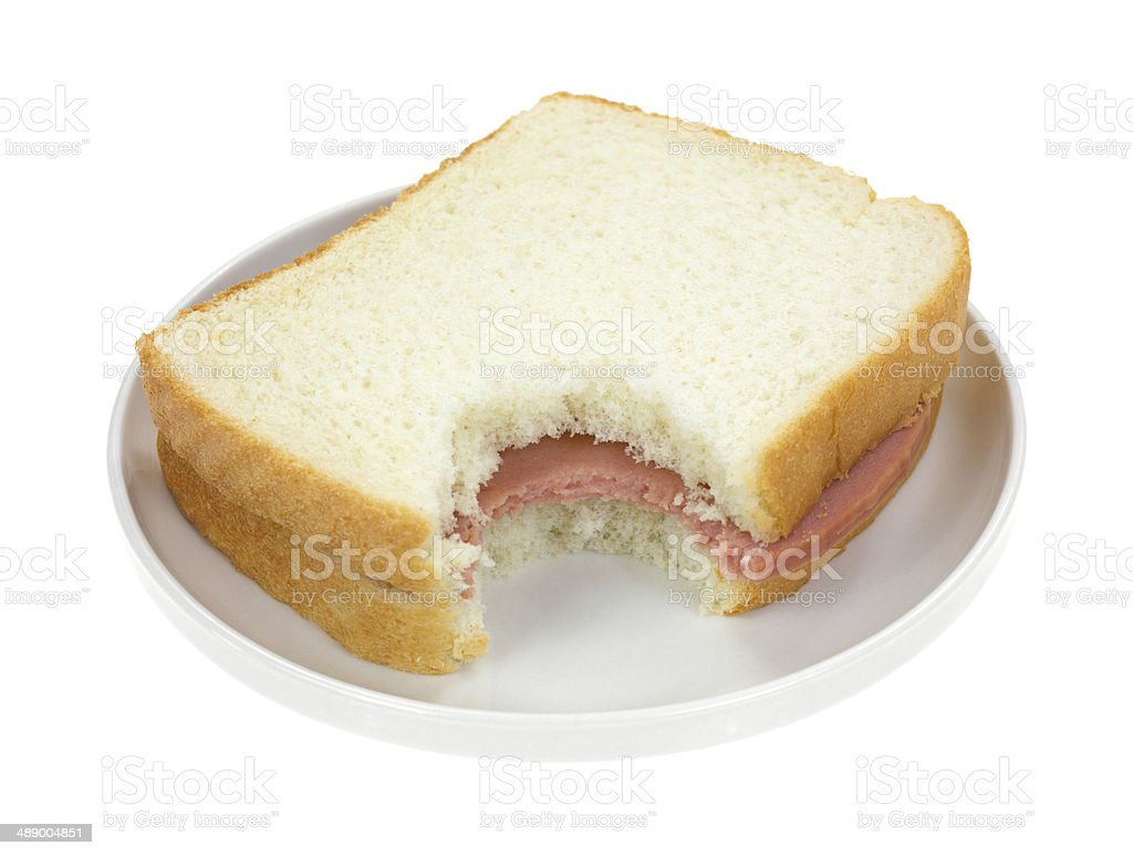 Bitten Baloney Sandwich On White Bread stock photo
