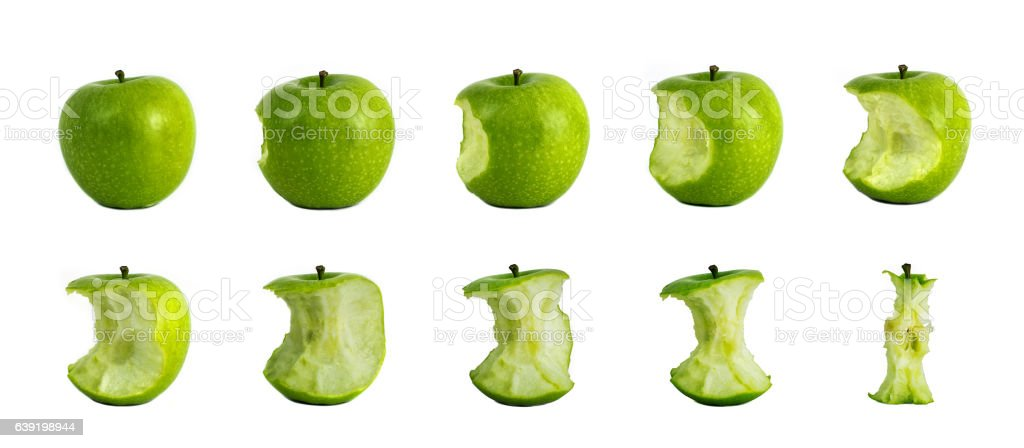Bitten Green Apples - Stages of eating green apple stock photo