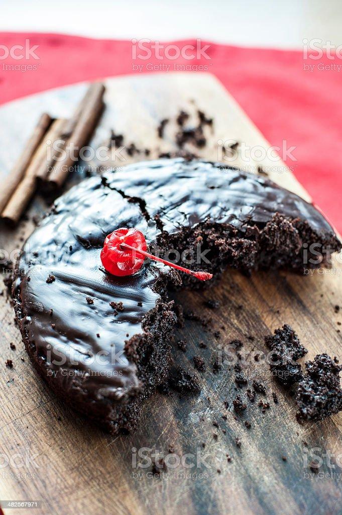 Bitten homemade round chocolate cake stock photo