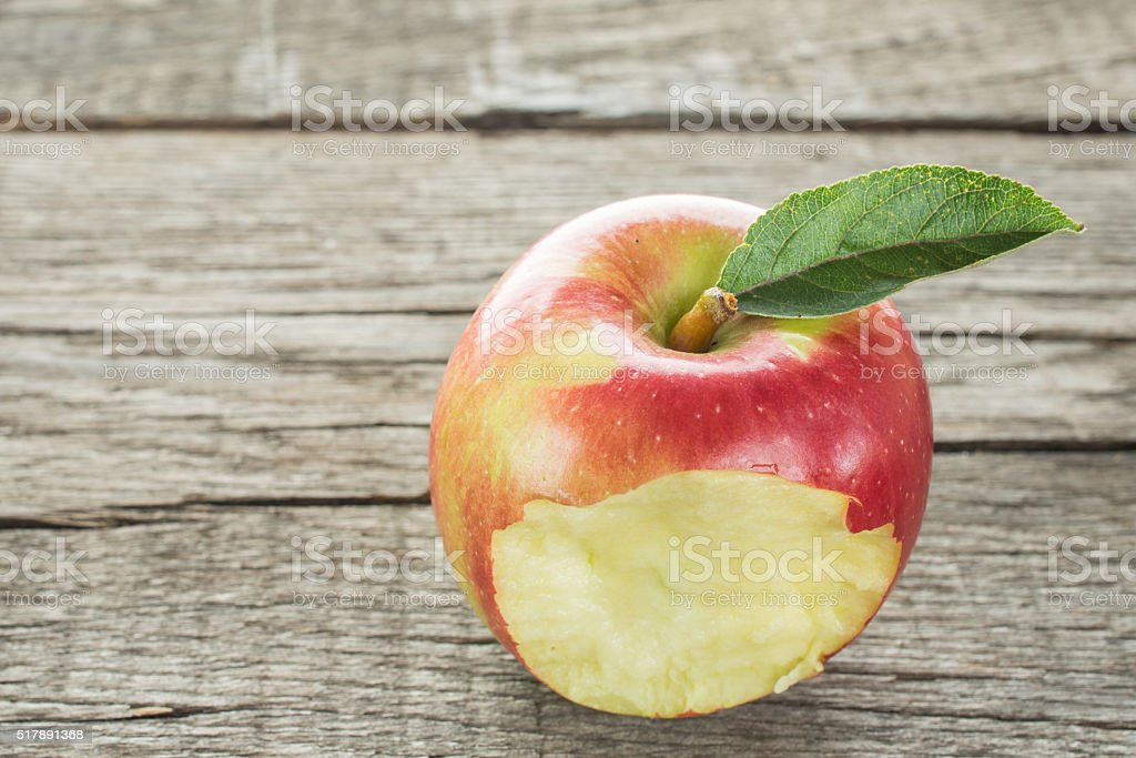 Bitten into a red apple stock photo