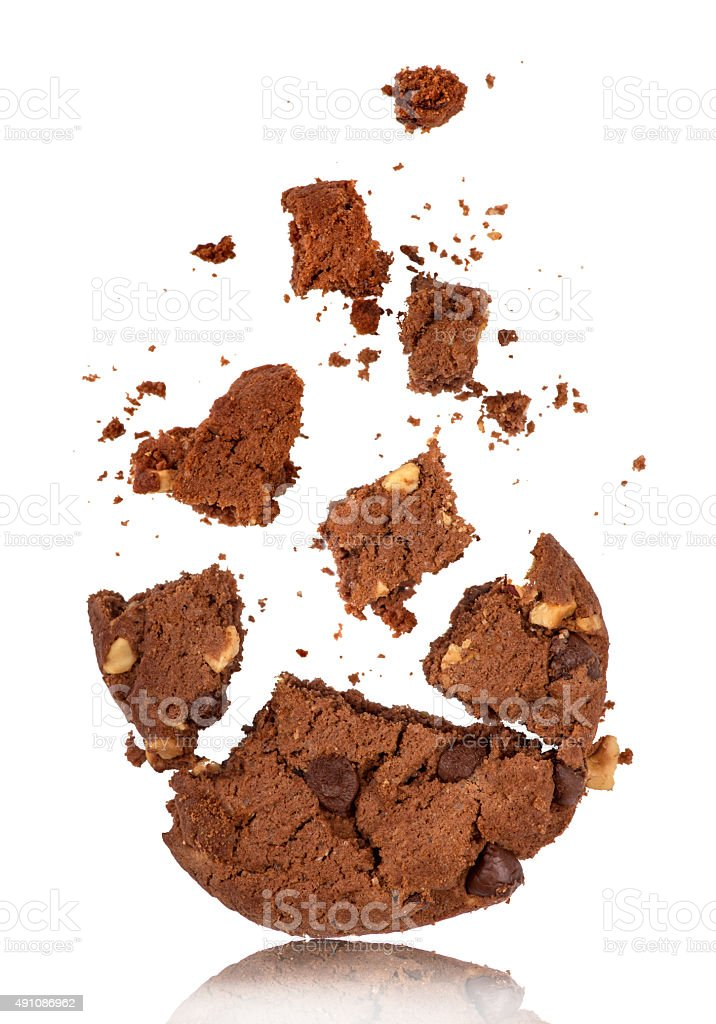 bitten into chocolate chip cookie with crumbs on white stock photo