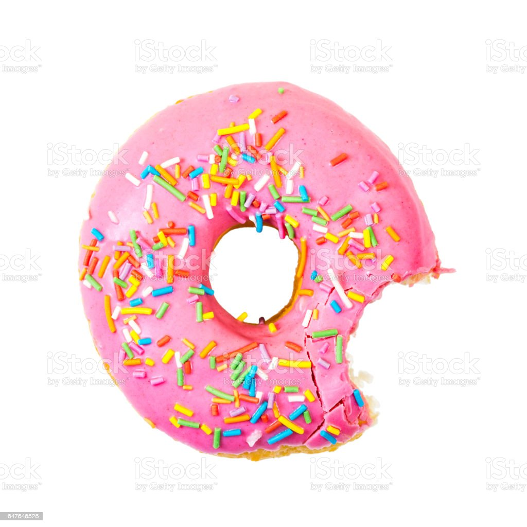 Bitten strawberry donut with colorful sprinkles. Top view. stock photo