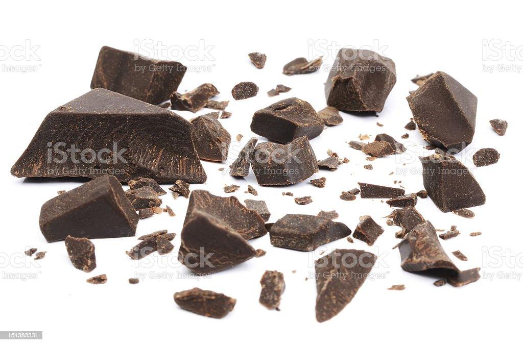Bitter chocolate broken in pieces stock photo
