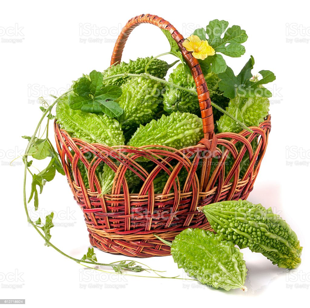 bitter melon or momordica in a wicker basket isolated on stock photo