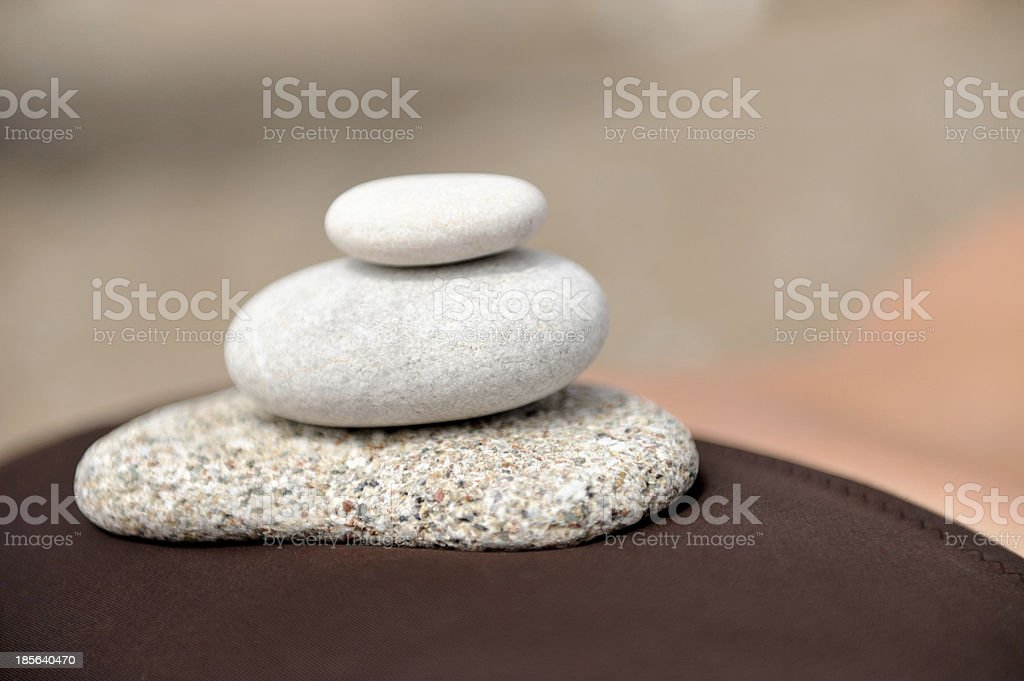 Bitter round stones on the body girl royalty-free stock photo