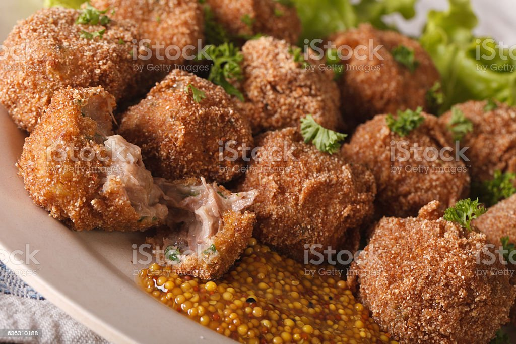 Bitterballen veal with mustard on a plate close-up. Horizontal stock photo