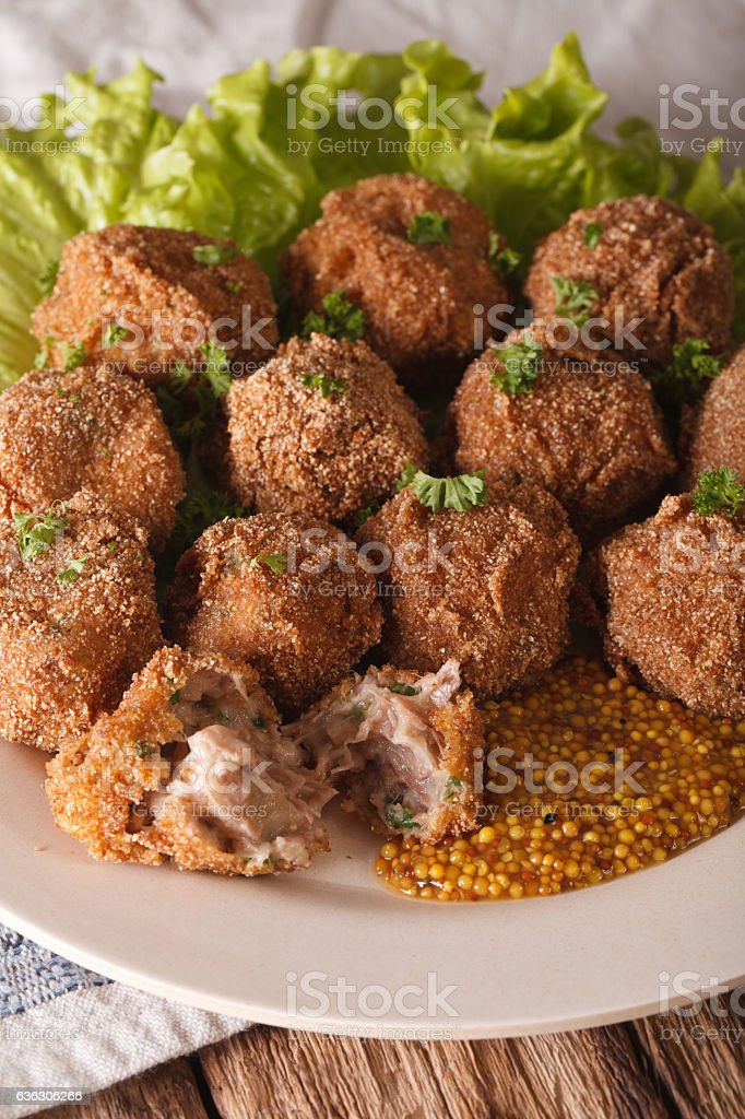 Bitterballen veal with mustard on a plate close-up. vertical stock photo