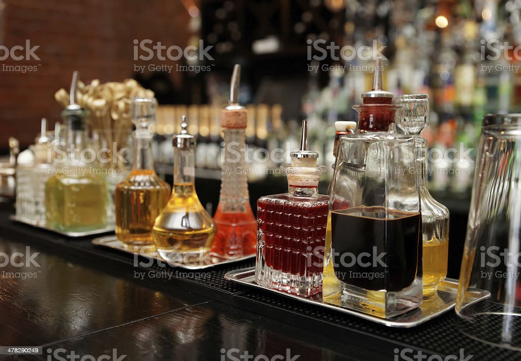 Bitters and infusions on bar counter stock photo
