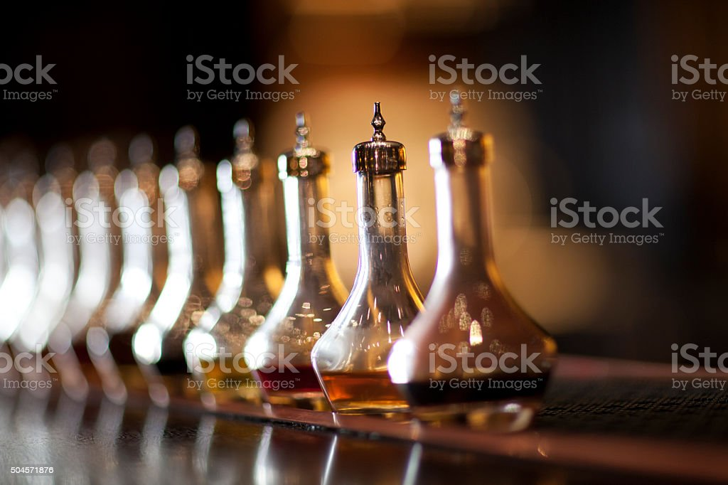 Bitters lined up on a bar stock photo
