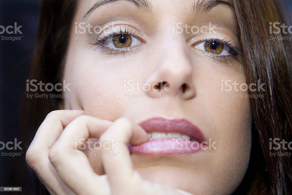 Bitting her fingernails royalty-free stock photo
