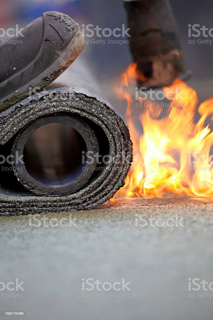 bitumen roofing felt roll for melting by gas heate stock photo