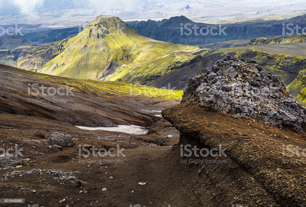 Bizarre lava formations and moss covered mountains. stock photo